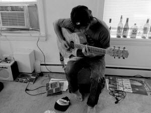 Mark Falcone playing guitar