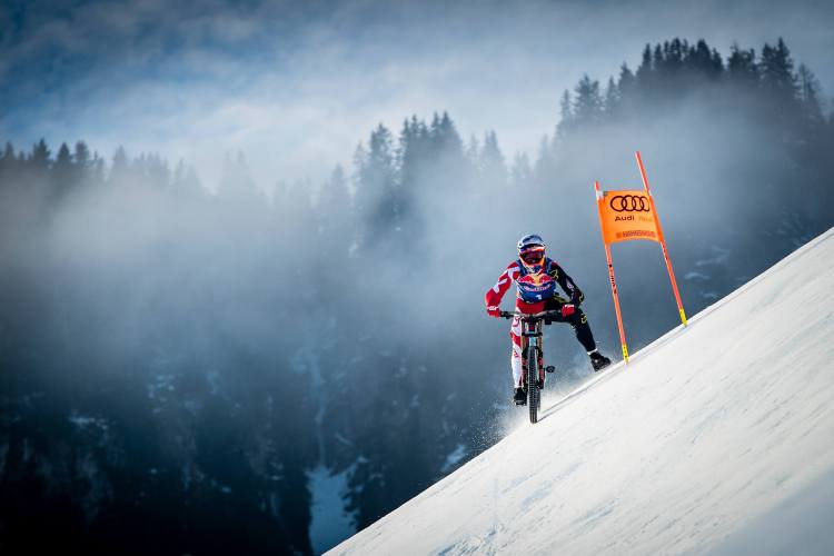 Markus Stoeckl races the Streif with his mountainbike in Kitzbuehel, Austria