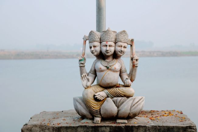 Three-headed Buddha statue. I