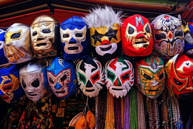 A slew of masks from Mexican wrestlers, lucahdors.