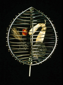 5.49 'A Sense of Place - Portmahomack' 1997. Brooch; white metal, amber, fossil, feather