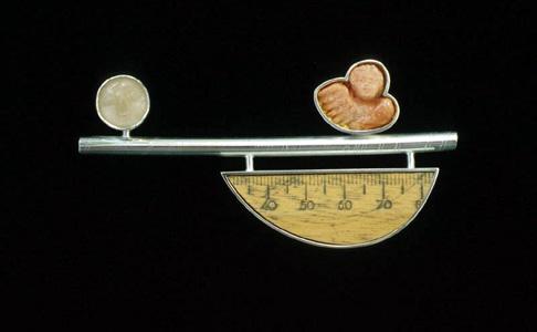 6.22 'Crossing II' 2000. Brooch; white metal, coral, wood, moonstone