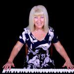 Jackie clark teaching the Piano