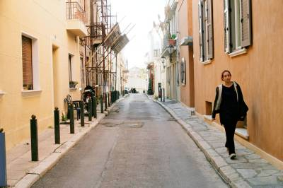 A woman walking down a narrow road