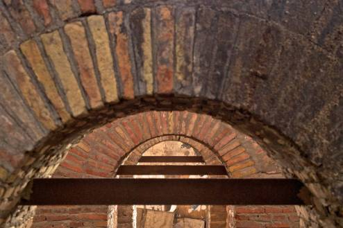 Arches on top of the doorways of an old building.