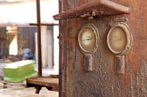 Gauges on an old and rusty generator engine.