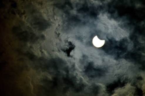 Solar Eclipse on a Cloudy Sky