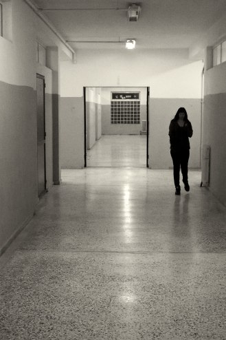 Girl walking in a corridor