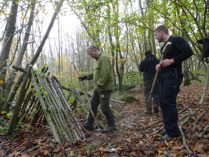 1 person debris shelter in a broadleaf woodland