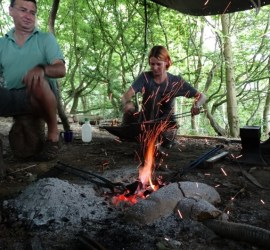 Woodland pit forge in use