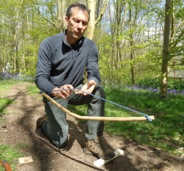 Posture and technique for bow drilling | IOL bushcraft competency | bow drilling | bushcraft | Kent | London | south east