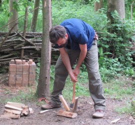 splitting with an axe on the ground | bushcraft | Kent | south east | London