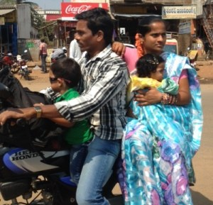 Family riding on motorbike