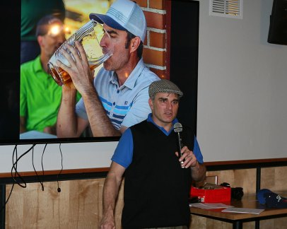 Mark Persinger, with photo of Jim Huckabay drinking from Seattle Cup