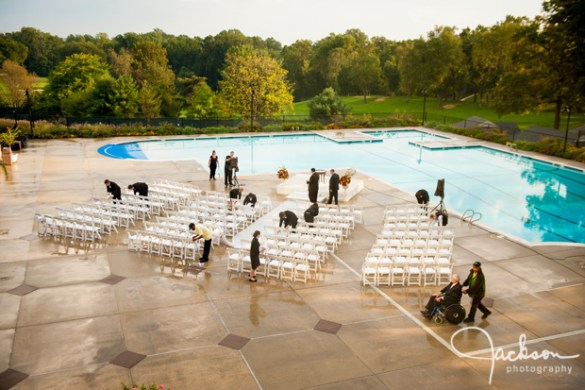 Lauren and Bryan at Woodholme Country Club   Jackson Photography     staff wiping down wet wedding ceremony chairs
