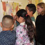 4th grade students placing stickers on a map of Colorado.
