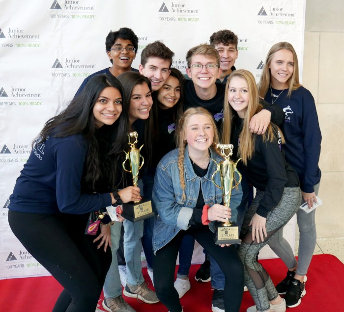 Students from Douglas County High School holding trophies at Junior Achievement Stock Market Challenge, presented by Wells Fargo