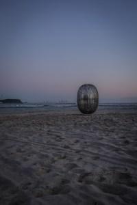 Superegg Coffee Capsule Sculpture at dusk