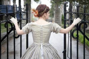 http://www.dreamstime.com/royalty-free-stock-photography-elegant-lady-vintage-dress-opens-wrought-iron-gate-image29882937