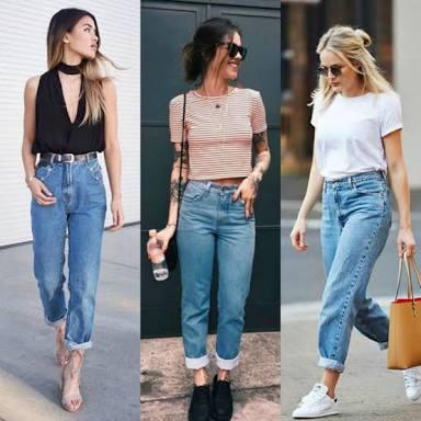 Modelo de cintura alta e corte reto? Confira as dicas de como usar mom jeans no estilo high low.