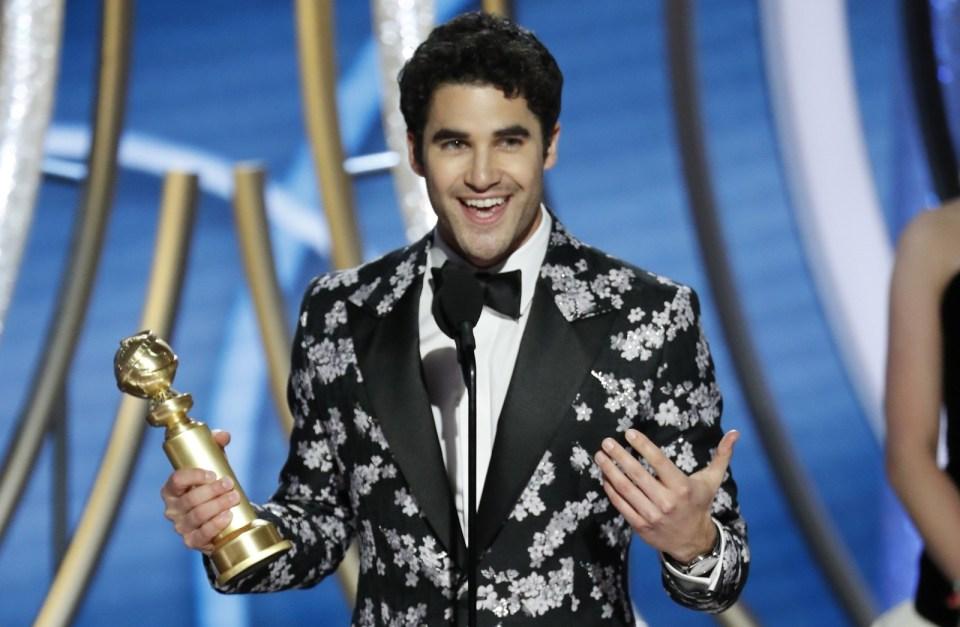 Darren Criss leva o Globo de Ouro de melhor ator em série limitada ou filme para TV por 'The Assassination of Gianni Versace: American Crime Story' — Foto: Paul Drinkwater/NBC via AP