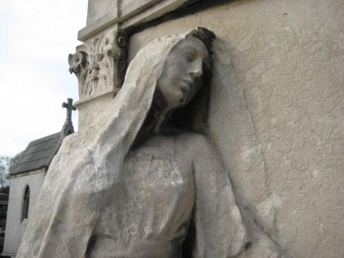 Closeup of woman and door - Père Lachaise Cemetery, Paris