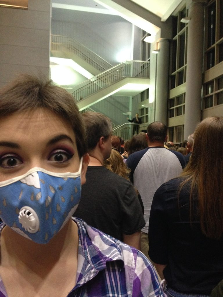 This is me at the last Eddie Izzard show (that's him in the background). I figured I'd give you an idea of what the masks look like, though this is my rainy day mask and not my polkadot one.