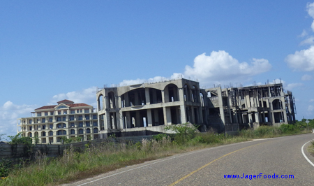 A new hotel is being built right behind an abandoned one.