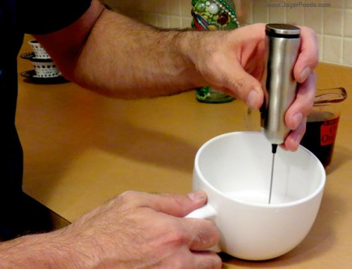 Nick is demonstrating the milk frother by #zenpro