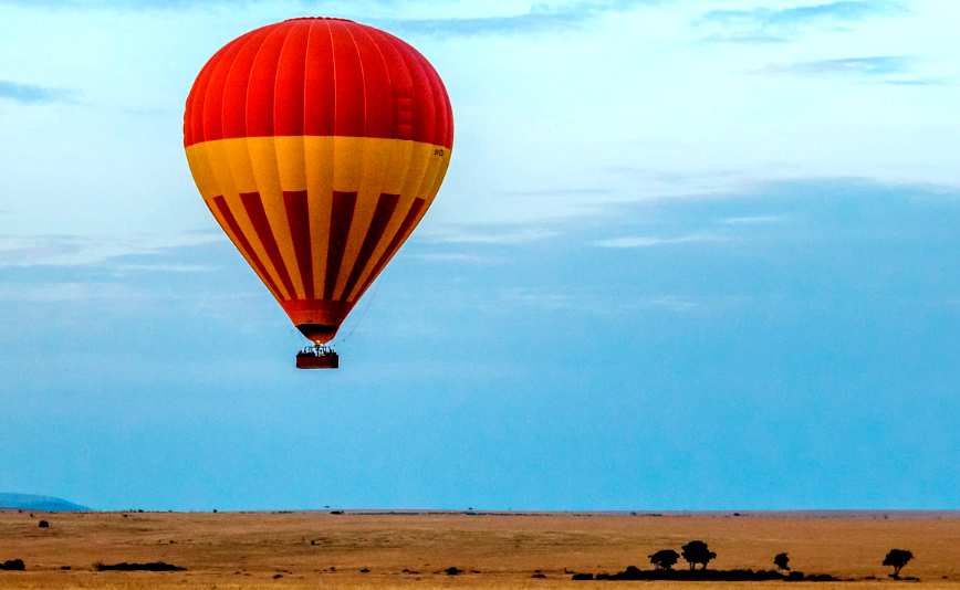 Ride a hot air balloon over a desert