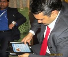 Munawwarali Shihab Thangal having a look at iJaihoon app