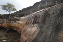 A series of bas-relief sculptures of Jaina tirthankaras on the rock surface adjacent to the natural cavern in a depression on the Kanakagiri hillock. Photo:K. BHAGYA PRAKASH