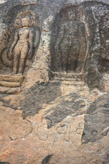Bas-reliefs of tirthankaras on the rock surface adjacent to the cavern. Below them are faded inscriptions in the Kannada script and language of the ninth/tenth century. Photo:K. BHAGYA PRAKASH