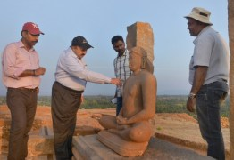 ASI officials near the sculpture of Adinatha found in a temple on the eastern side of the hillock. From left are T. Arun Raj, Superintending Archaeologist , Bangalore Circle; K. P. Poonacha, former Joint Director General; R.N. Kumaran and P. Aravazhi, both Assistant Archaeologists. Photo:K. BHAGYA PRAKASH