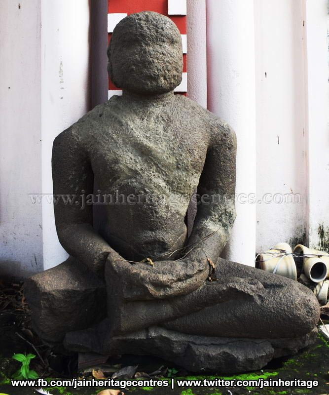 Ruined Tirthankar idol in padmasana - Jain Museum