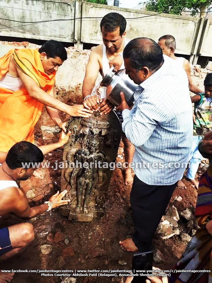Members of Jain community washing the Tirthankar Idol.