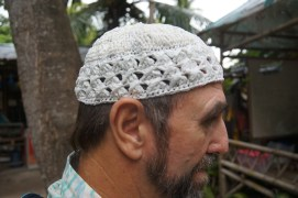 Islamic prayer hat, made from white plastic bags.