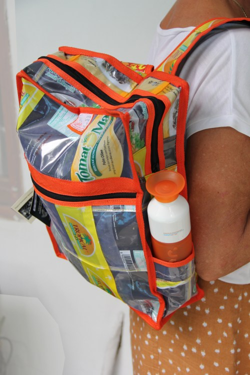 Backpack made from plastic. Complete with drink bottle holder.