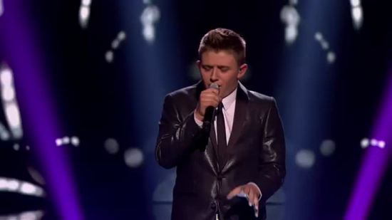 "Viewers saw Nicholas McDonald mature on the tenth season of ""X Factor UK"" and his cover of ""Superman"" cemented his place in the recording industry. (Photo property of ITV & SYCO TV)"
