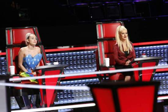 "Miley Cyrus and Christina Aguilera rehearse with a contestant during a taping of ""The Voice: Season 10"" Knockout Rounds. (Photo property of NBC & United Artists Media Group)"