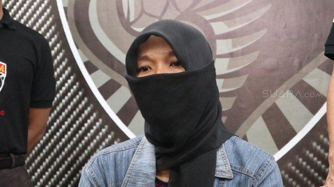 Lasmini, istri yang digadaikan Hori ke orang lain seharga Rp 250 juta. (Suara.com/Achmad Ali)