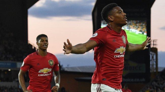 Duo penyerang Manchester United, Anthony Martial (kanan) dan Marcus Rashford. [Paul ELLIS / AFP]