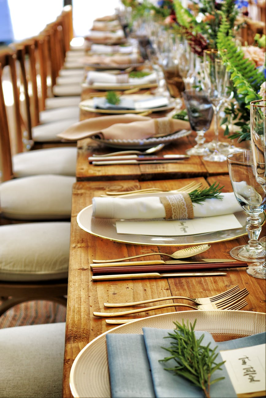 close up photo of dinnerware set on top of table with glass cups