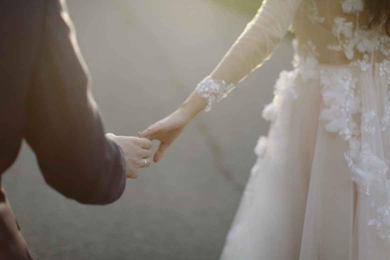 newlyweds holding hands