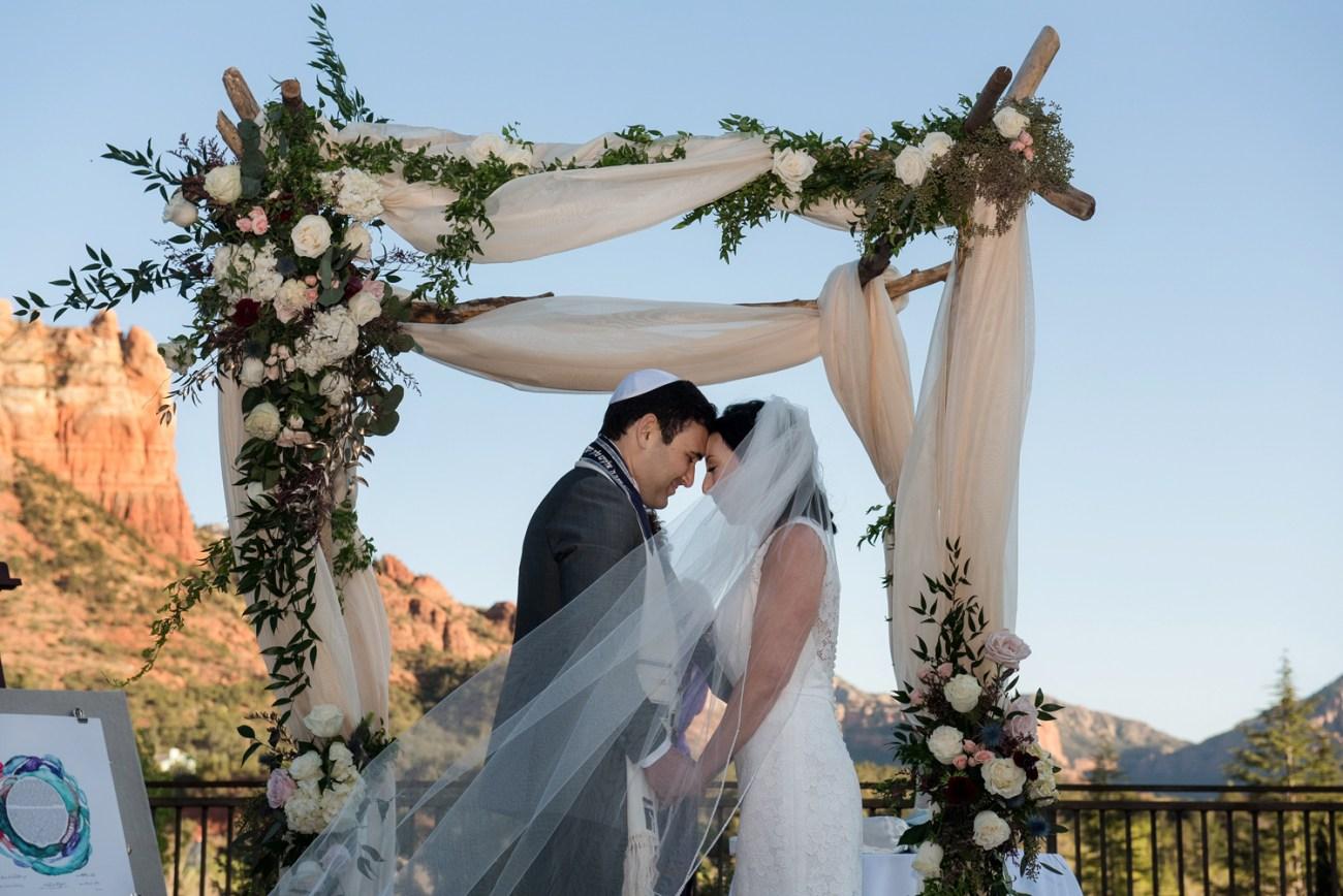 Sedona bride and groom under the chuppah