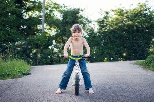 Portrait of a boy on a balance bike