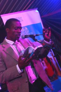 Reading from the book. Photo/Fungai Machirori