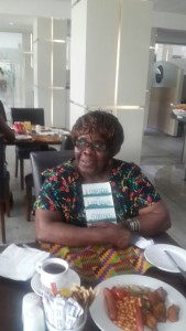 Ama Ata Aidoo with a copy of London Cape Town Joburg