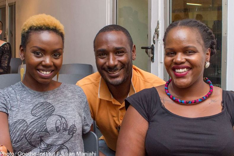 Patricia Kihoro, Paul Munene and unidentified audience member
