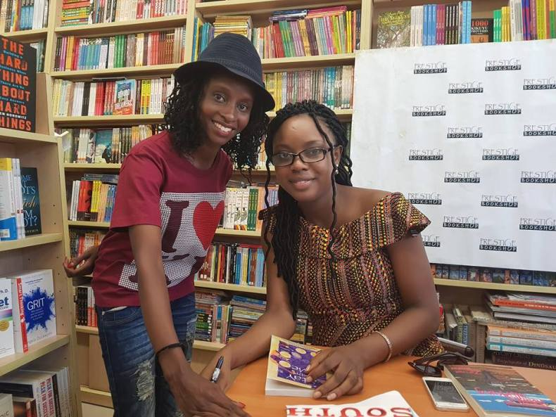 Ayobami with a fan at Prestige books